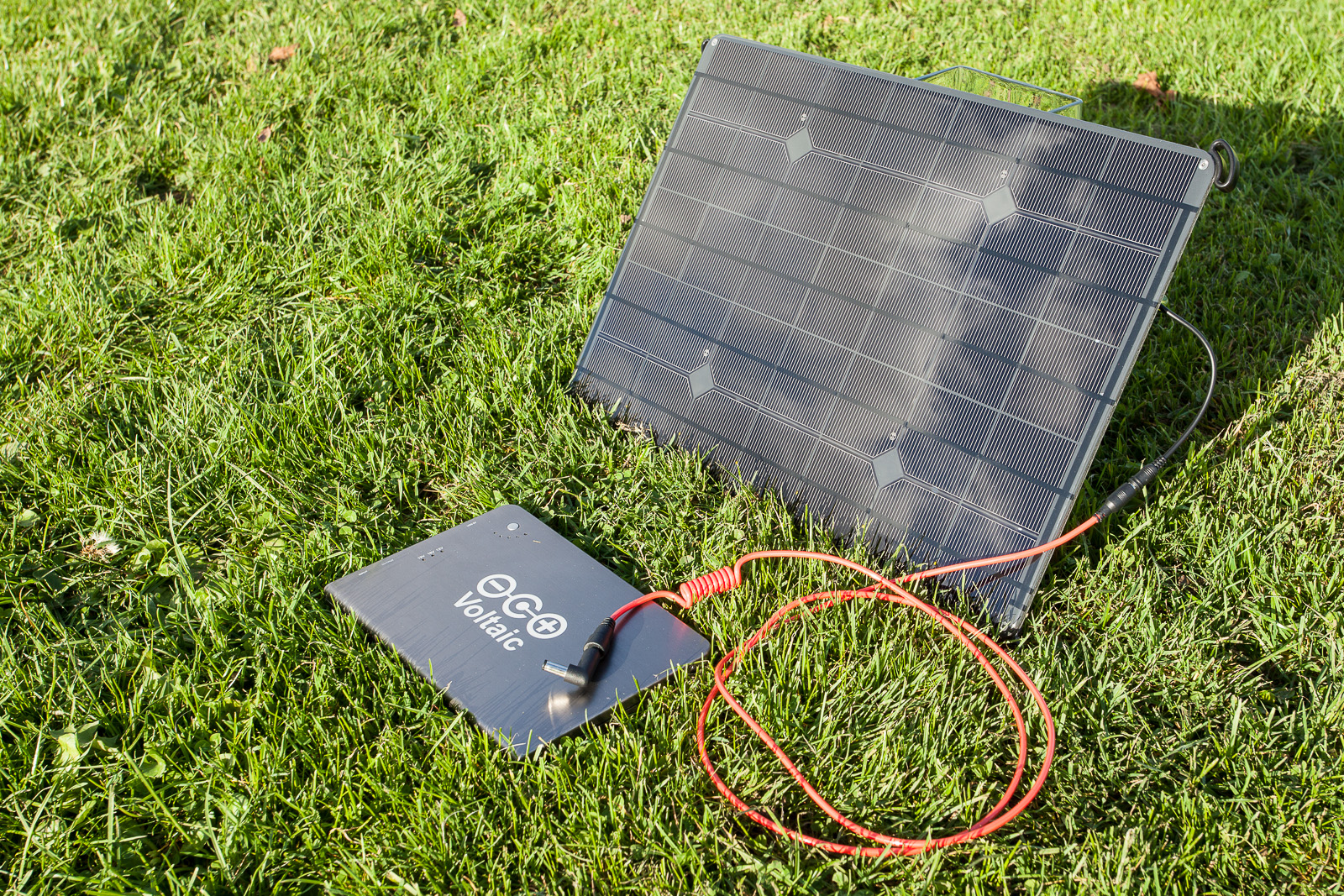 The core elements of the solar charging kit: The panel, the battery and a cable to connect the two...