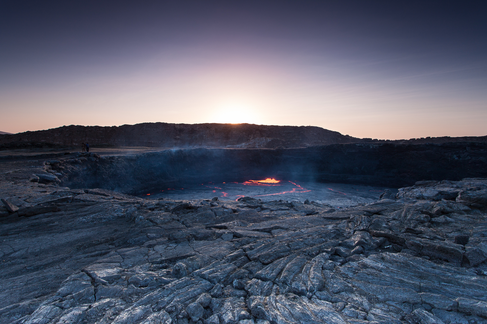 The lava lake at dawn is surrounded by a fragile lava landscape with its own unique beauty. [Click to enlarge!] (20mm, 1/15sec @ f/8, ISO 100)