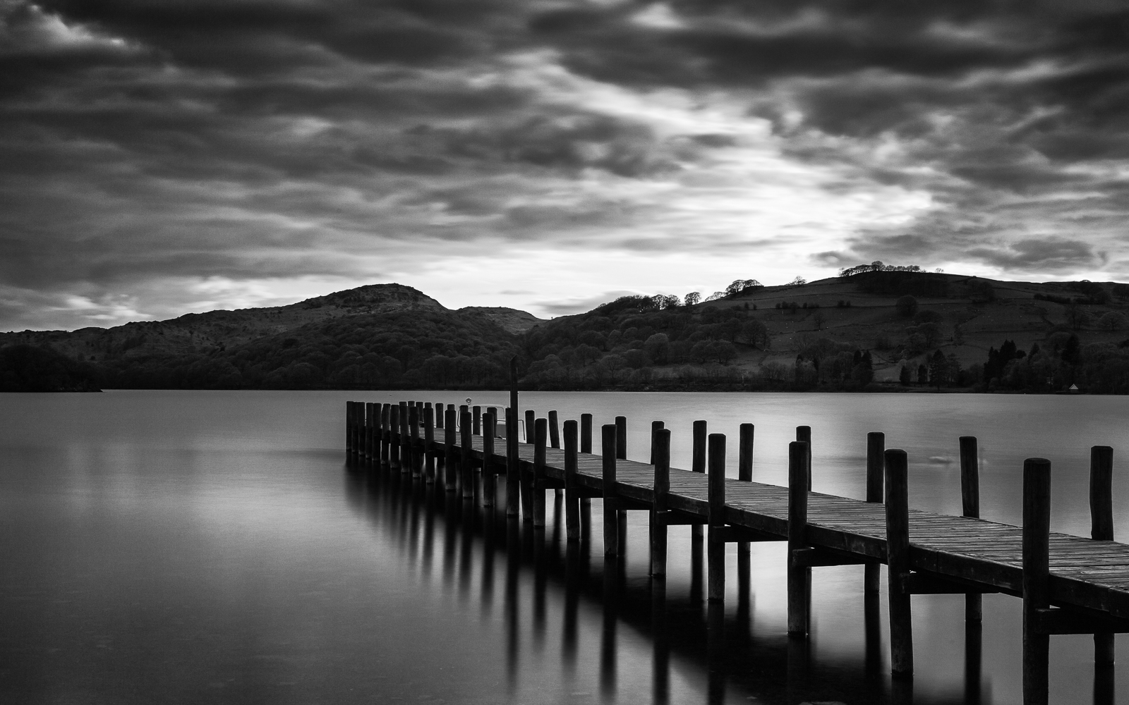 The sun eventually dips below the mountains as the storm clouds move in. Windermere may be the most popular lake in the Lake District but I prefer the quietness of Coniston Water.