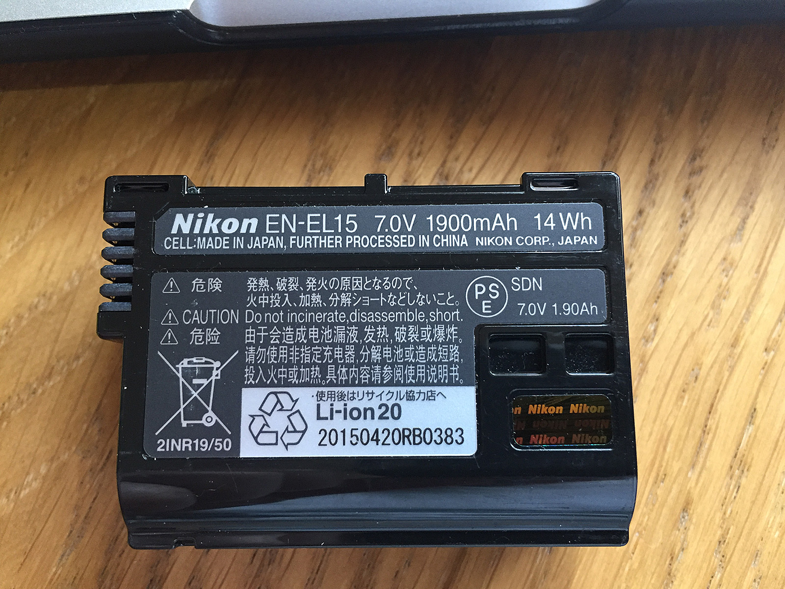 Here the Nikon EN-El15 specifies the watt-hour capacity from which we can calculate the single cell equivalency as 3780mAh.