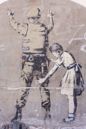 'Girl Frisking a Soldier' by Banksy. [Bethleham, Palestine]